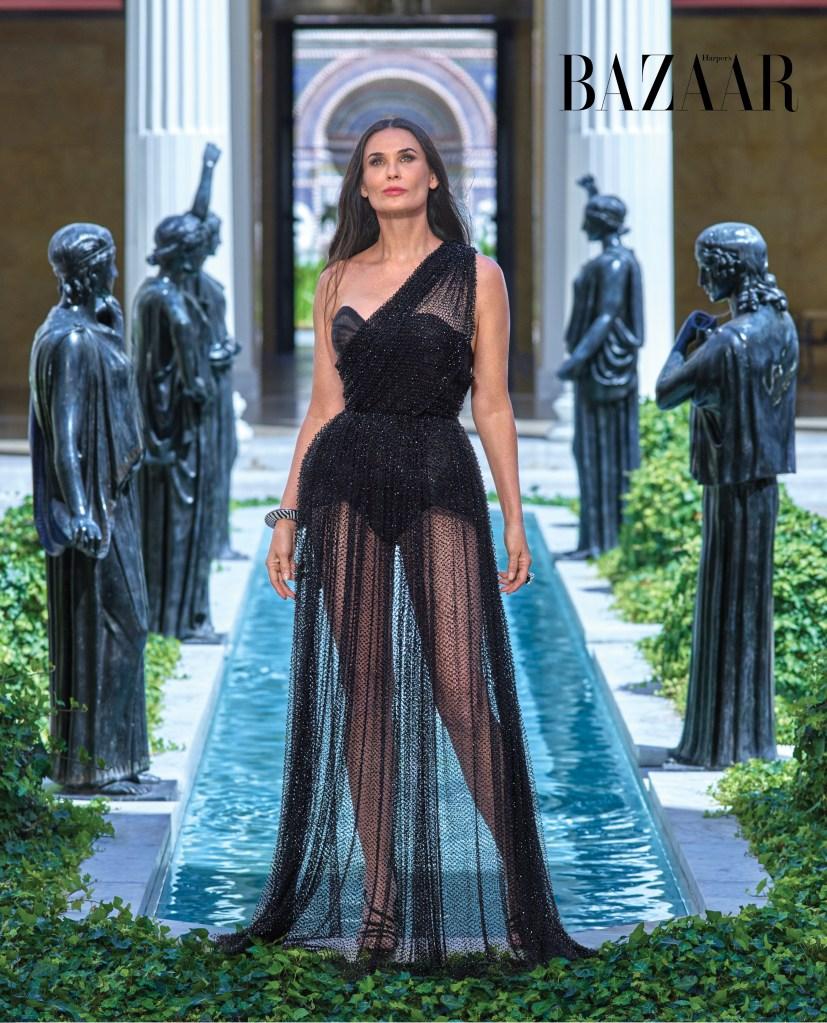 Demi Moore wears a black dress for Harper's Bazaar