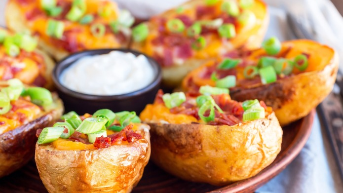 Baked loaded potato skins with cheddar