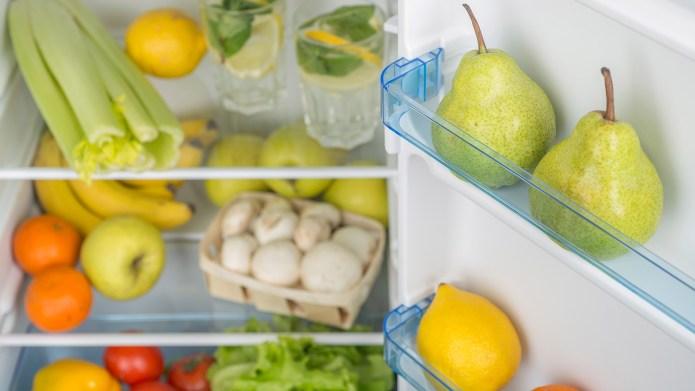 Open fridge full of fresh fruits