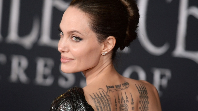 Angelina Jolie Walks The Maleficent Red Carpet With Her