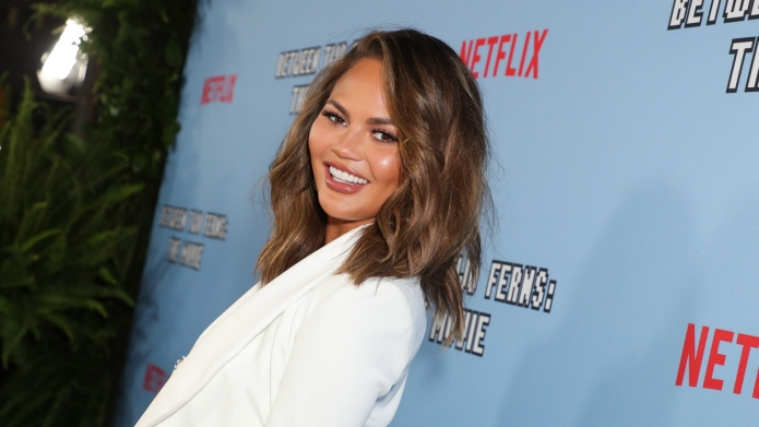 Chrissy Teigen Getting Competitive Over Hot Potato Is Every Parent With a 3-Year-Old