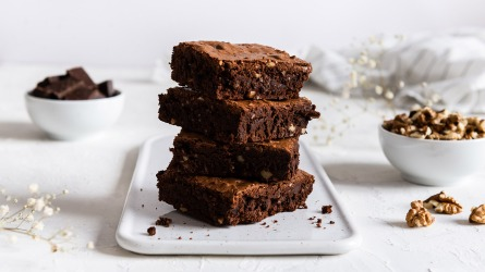 Homemade dark chocolate brownies on white