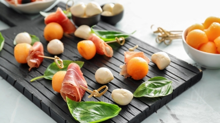 Delicious melon balls with prosciutto and