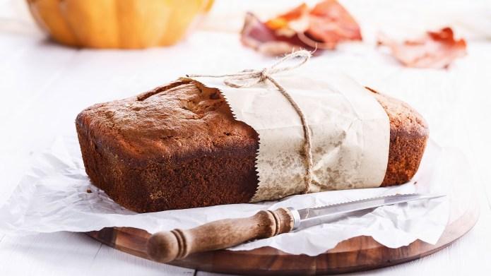 Pumpkin bread loaf over white wooden