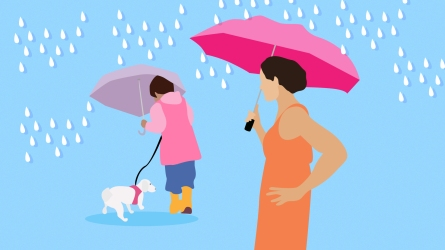 Older mom and child in rain