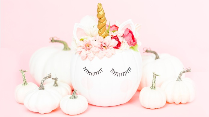 White unicorn pumpkin decorated with flowers
