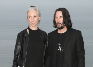 Alexandra Grant and Keanu Reeves at a Saint Laurent Show in June 2019.