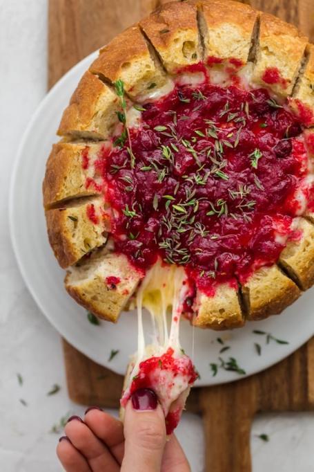 Baked brie cranberry in bread bowl