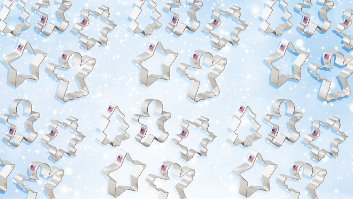 cookie cutters on snowy background