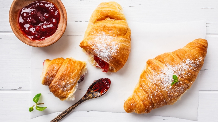 Croissants with berry jam on a