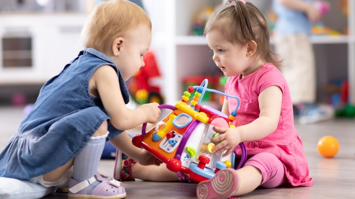 two-children-playing-with-toys