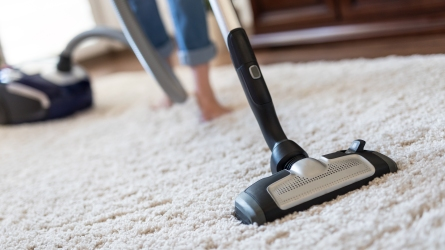 vacuum cleaner - woman vacuuming rug