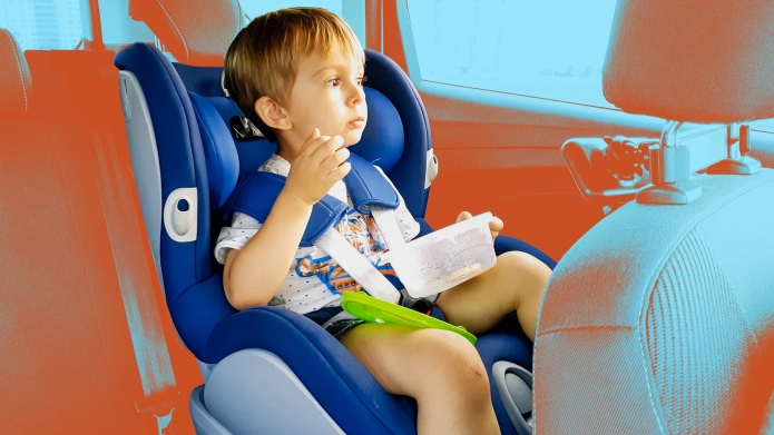 Child eating in carseat