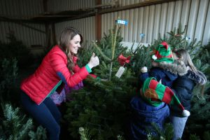 Catherine Duchess of Cambridge picks a Christmas tree with children during a visit to Peterley Manor Farm in Buckinghamshire, where she will take part in Christmas activities with families and children who are supported by the Family Action charityCatherine Duchess of Cambridge marks new patronage of Family Action, Peterley Manor Farm, Great Missenden, Buckinghamshire, UK - 04 Dec 2019