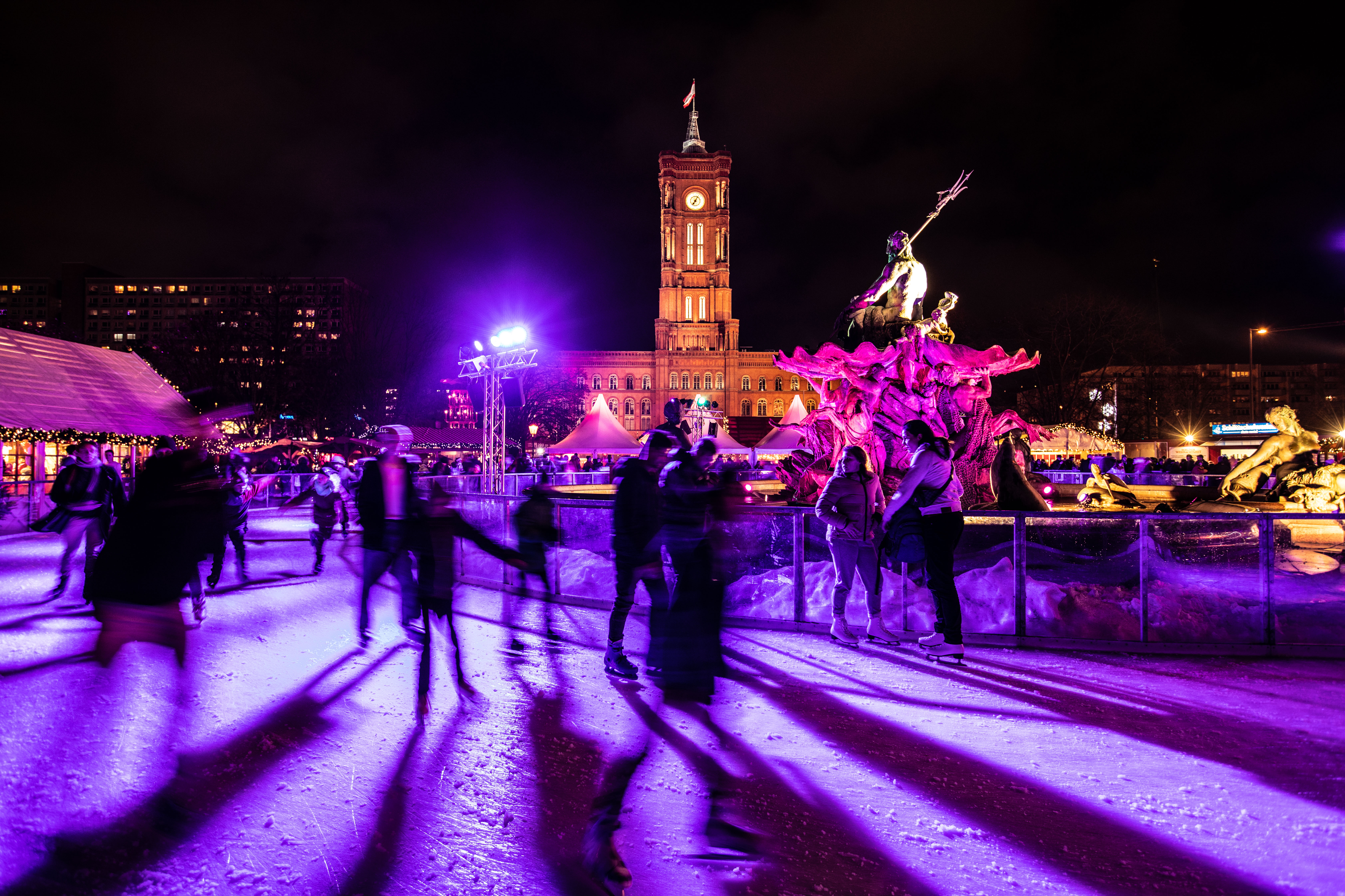People enjoy ice-skating at the Christmas market in front of Berlin's city hall 'Rotes Rathaus' at the Alexanderplatz in Berlin, Germany, 25 December 2019.Christmas in Berlin, Germany - 25 Dec 2019