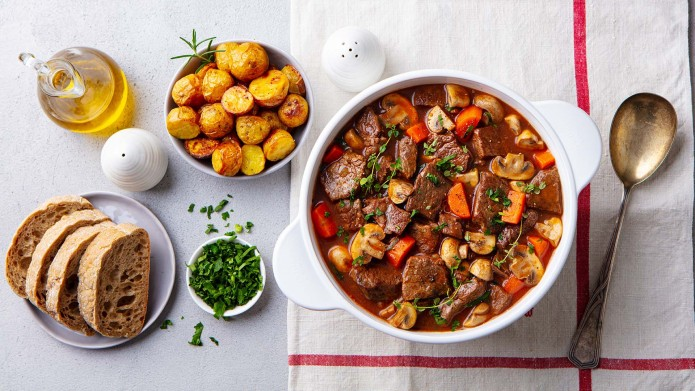 Beef bourguignon stew with vegetables. Grey