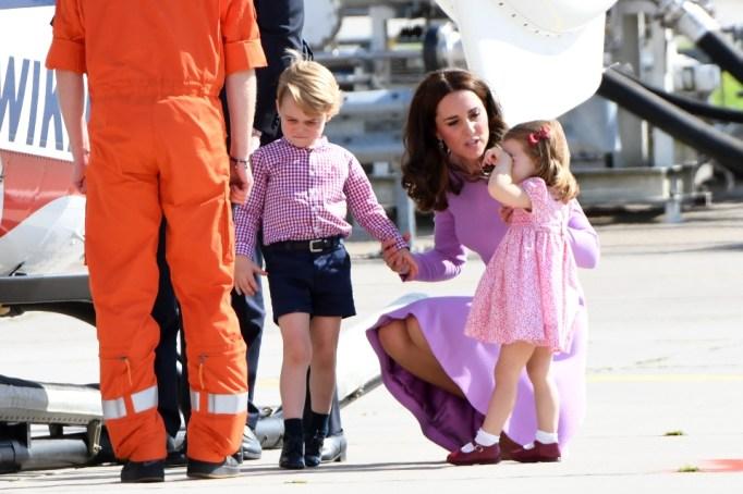 Kate Middleton comforting Priness Charlotte.