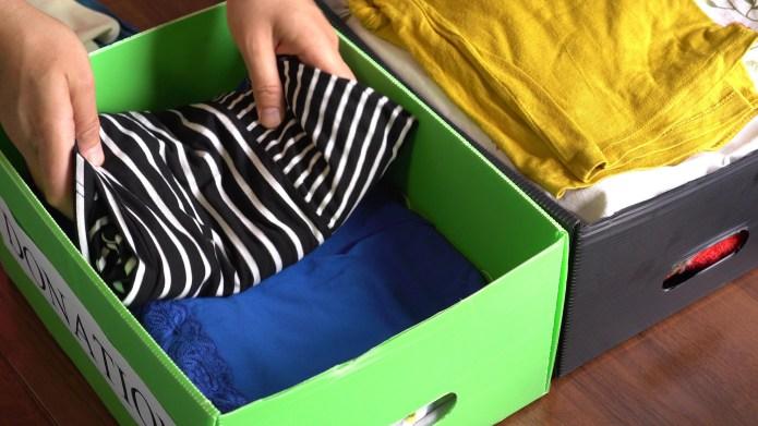 clothes in storage bins