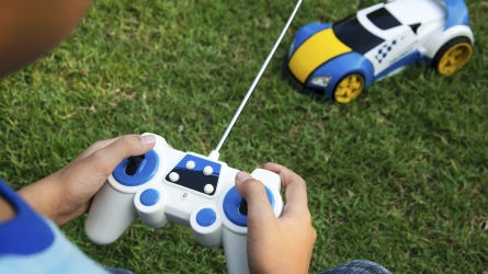 child playing with remote control car