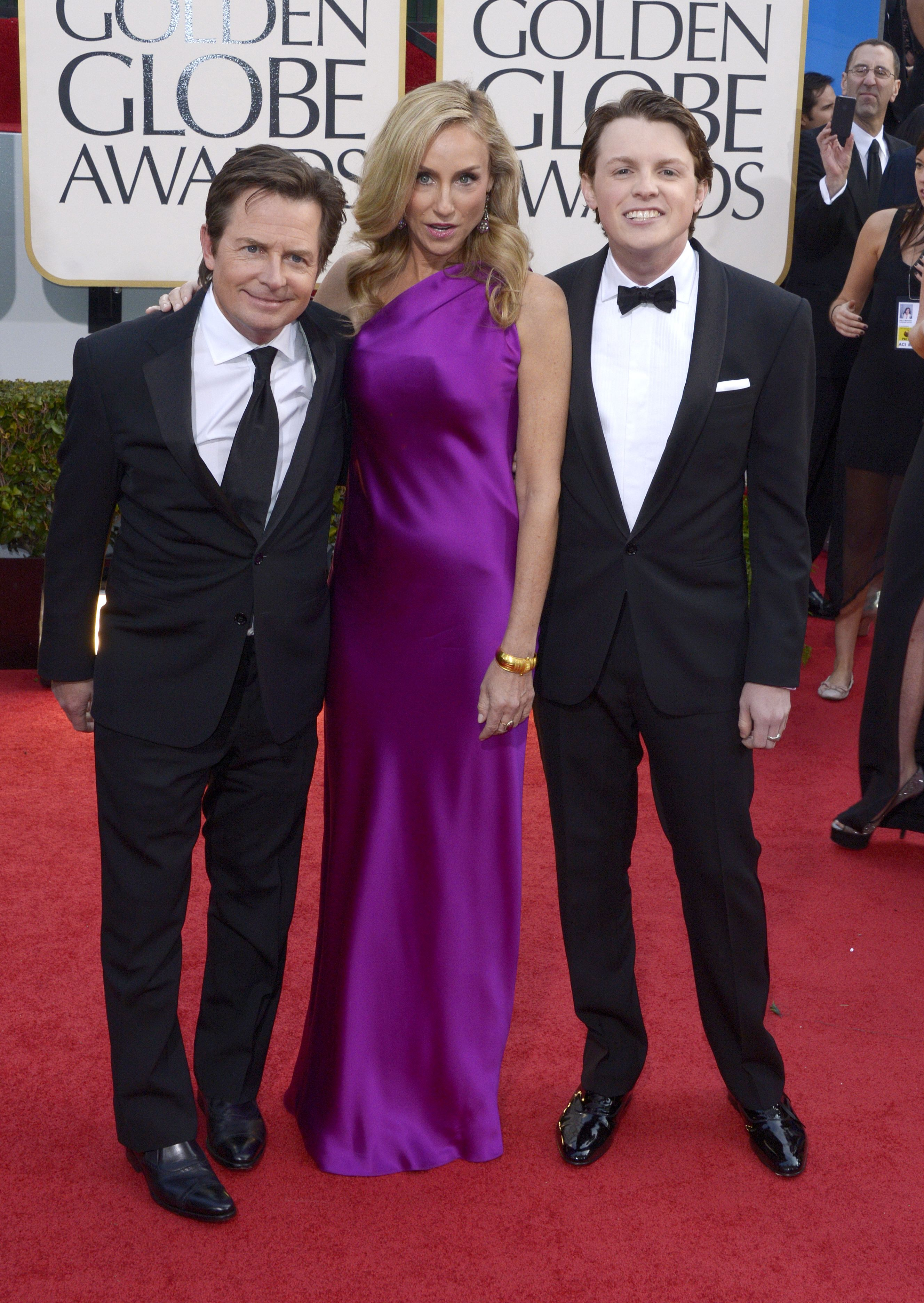 (l-r) Us Actors Michael J Fox Us Actress Tracy Pollan and Mr Golden Globe Sam Fox Arrive For the 70th Annual Golden Globe Awards Held at the Beverly Hilton Hotel in Beverly Hills Los Angeles California Usa 13 January 2013 United States Beverly HillsUsa Golden Globes 2013 - Jan 2013