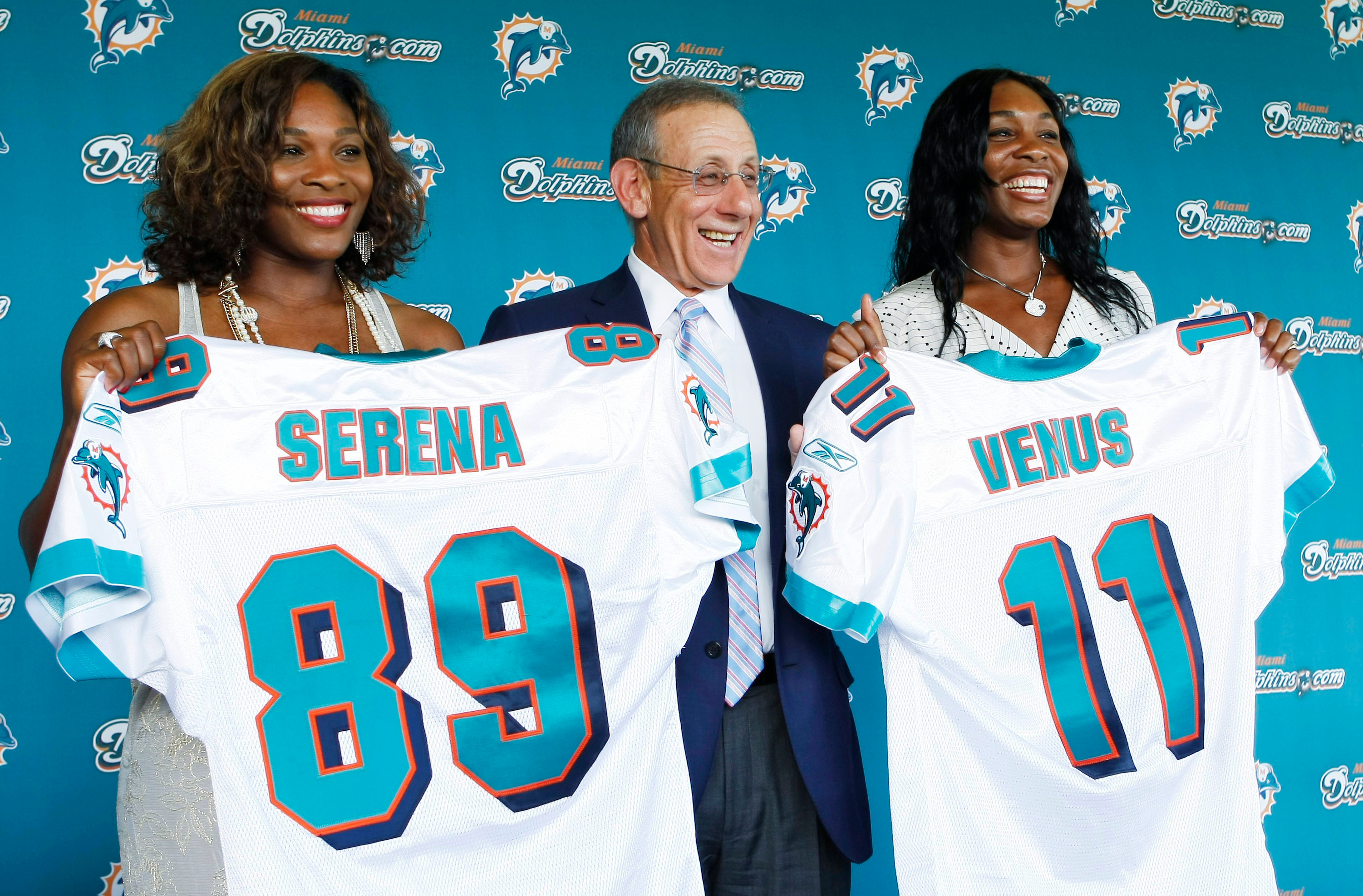 Venus Williams, Serena Williams, Stephen Ross. Miami Dolphins owner Stephen Ross, center, stands between Serena, left, and Venus Williams after it was announced the tennis stars had become minority owners of the NFL football team, during a news conference at the team's training complex in Davie, FlaDolphins Williams Sisters Football, Davie, USA - 25 Aug 2009