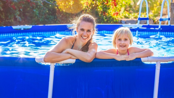 mom and child swimming in above-ground