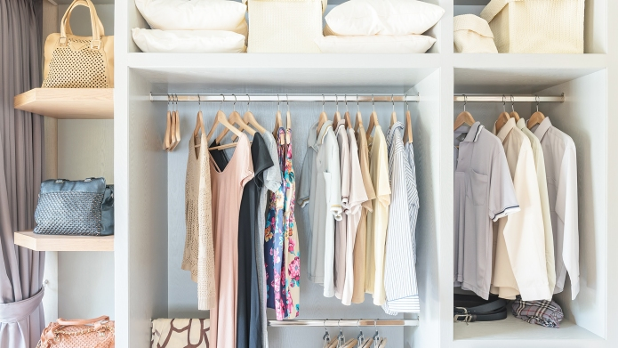 clothes hanging on rail in wooden