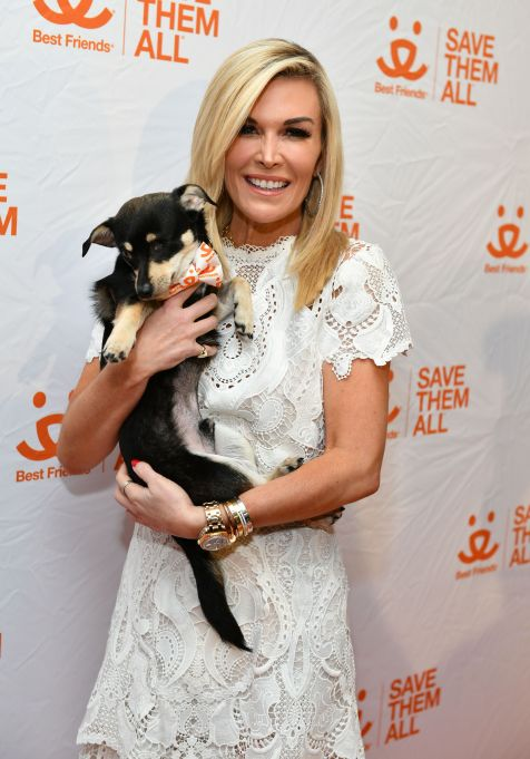 Tinsley Mortimer holding a puppy