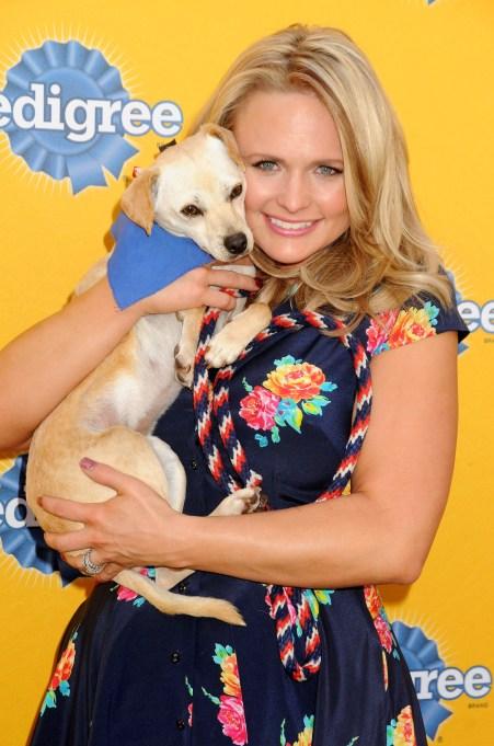 Miranda Lambert holding a puppy