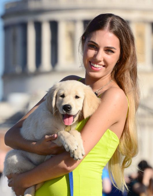 Amber le Bon with a Smiling Puppy