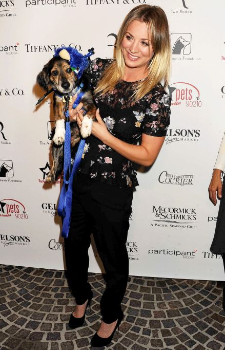 Kaley Cuoco Holding a Puppy