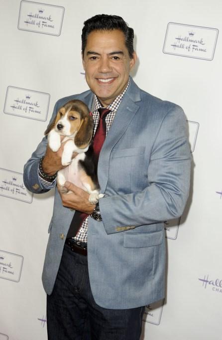 Carlos Gomez Holding a Beagle Puppy