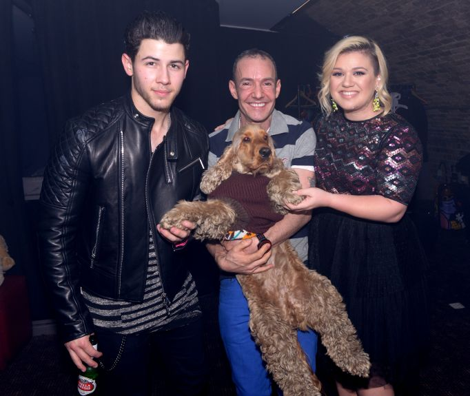 Kelly Clarkson, Nick Jonas, and Jeremy Joseph Holding a Puppy Together