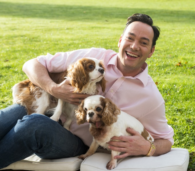Craig Revel with His Two Puppies