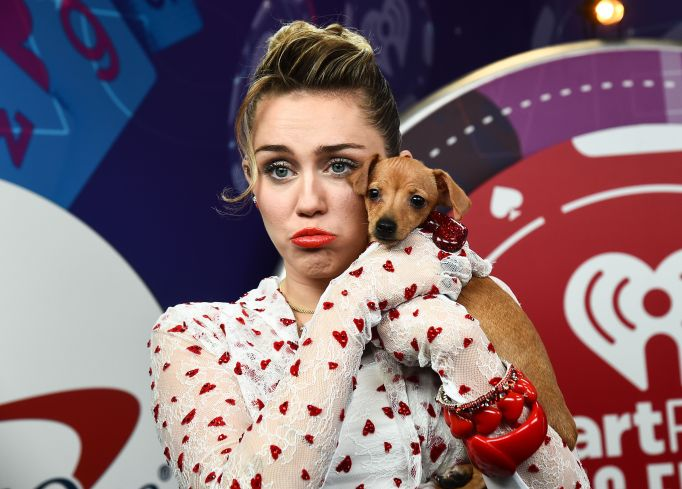 Miley Cyrus Frowning with a Puppy