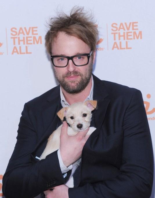 Joshua Leonard holding a puppy