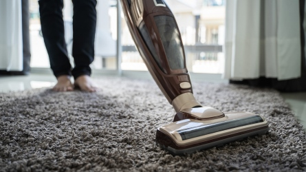man using a vacuum cleaner