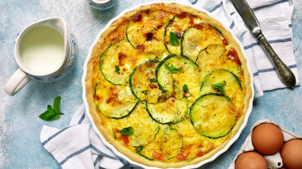Delicious summer quiche with zucchini in