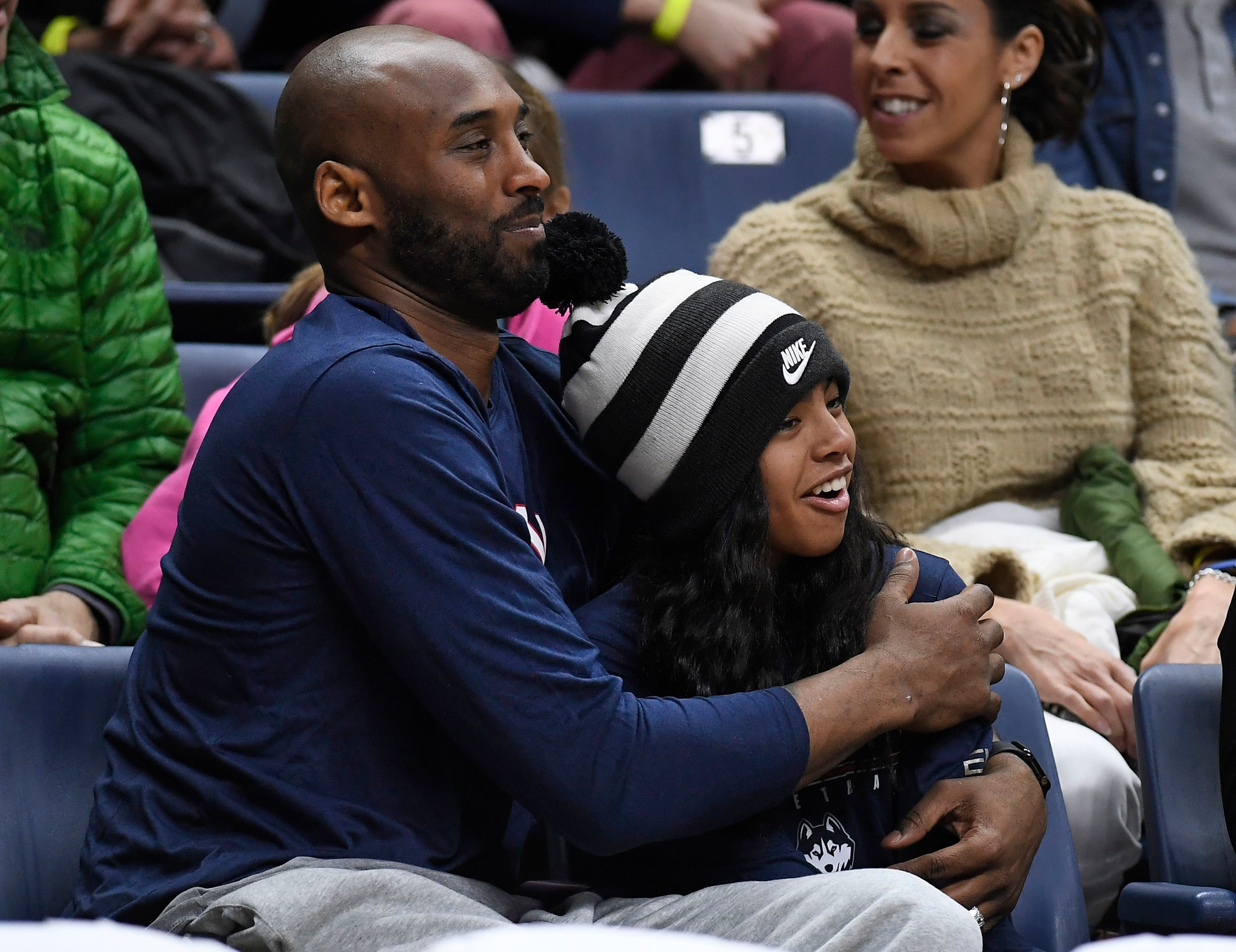 Kobe Bryant and his daughter Gianna Bryant watch the first half of an NCAA college basketball game between Connecticut and Houston, in Storrs, ConnHouston UConn Basketball, Storrs, USA - 02 Mar 2019