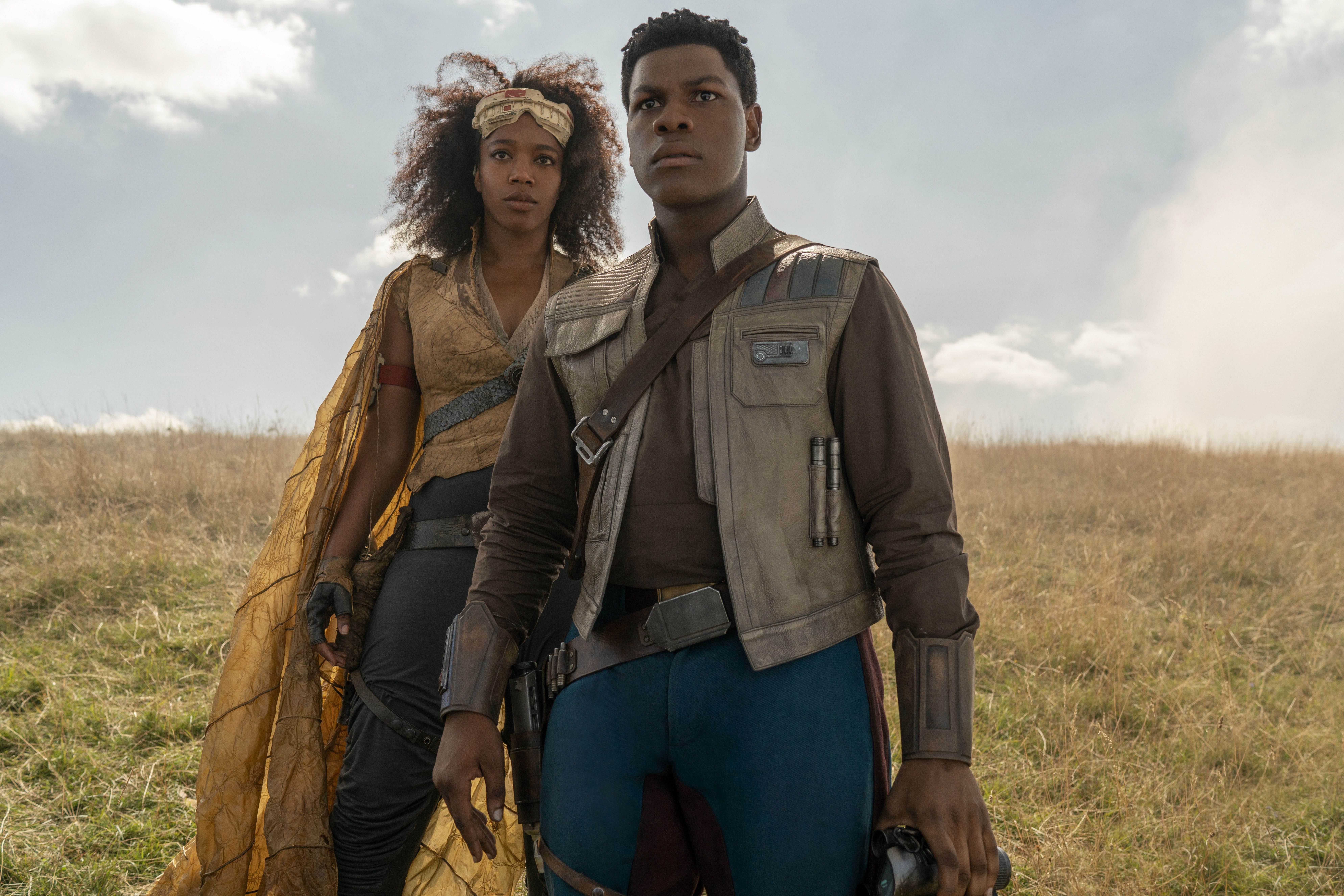 Editorial use only. No book cover usage.Mandatory Credit: Photo by J Wilson/Lucasfilm/Disney/Kobal/Shutterstock (10509667f) Naomi Ackie as Jannah and John Boyega as Finn 'Star Wars: The Rise of Skywalker' Film - 2019 The surviving members of the resistance face the First Order once again, and the legendary conflict between the Jedi and the Sith reaches its peak bringing the Skywalker saga to its end.