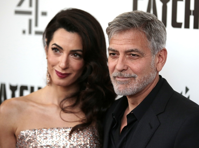 George Clooney, Amal Clooney. Actor George Clooney and partner Amal Clooney, pose for photographers on arrival at the premiere of the television mini-series 'Catch22', in London