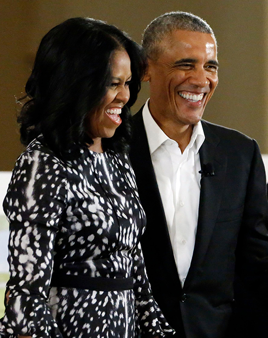 Barack Obama, Michelle Obama Former President Barack Obama and former first lady Michelle Obama smile as they arrive at a community event on the Presidential Center at the South Shore Cultural Center, in Chicago. The Obama Foundation unveiled plans for the former president's lakefront presidential center, showcasing renderings and a model at an event where former President Barack Obama and first lady Michelle Obama were expected to give more detailsObama Library, Chicago, USA - 03 May 2017