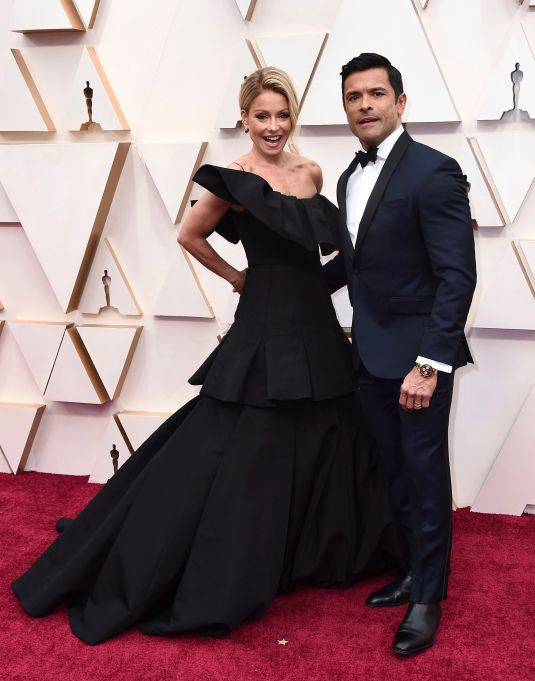 Kelly Ripa, left, and Mark Consuelos arrive at the 92nd Academy Awards