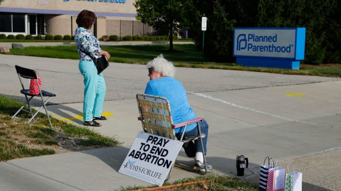 Abortion protesters stand in the driveway