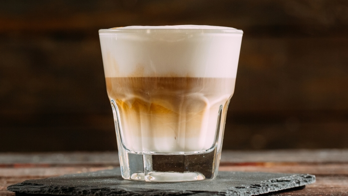 Tasty Ice Latte on Wooden Background;