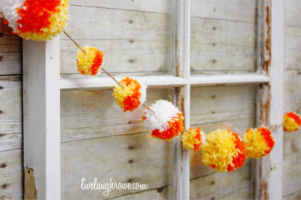 9 Halloween Crafts That Are Super Cute Without Being Cheesy: Candy Corn Pom-Pom Garland