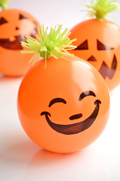 9 Halloween Crafts That Are Super Cute Without Being Cheesy: Candy Filled Balloon Pumpkins
