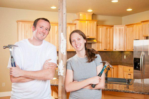 couple remodeling kitchen