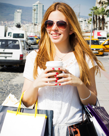 Woman with coffee shopping