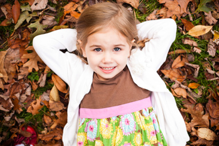 Little girl wearing a cardigan in the fall